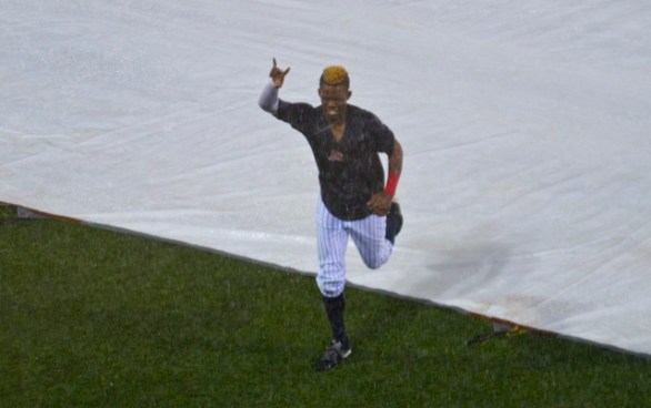 After the game was suspended, Errol Robinson went for a tarp slide. (Photo: Shotgun Spratling)