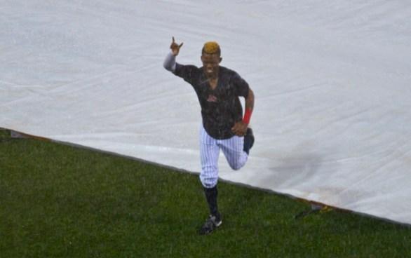 After the game was suspended, Errol Robinson went for a tarp slide. (Photo: Shotgun Spratling)