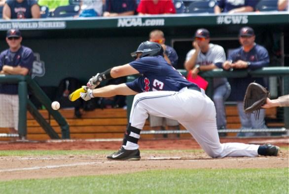 Austin Knight lays down a sacrifice. (Photo: Shotgun Spratling)
