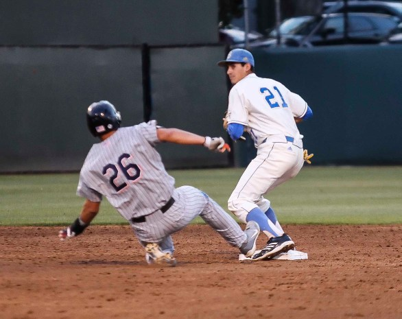 Luke Persico can't turn a double play with J.D. Davis barreling down on him. (Photo: Mark Alexander)