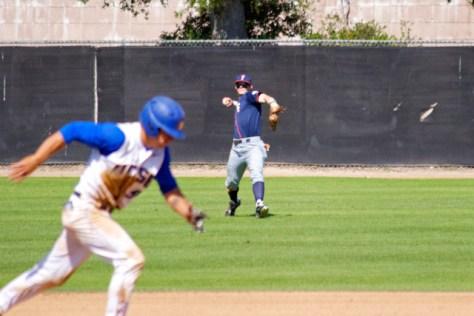 Austin Diemer tries to double up a runner. (Photo: Shotgun Spratling)