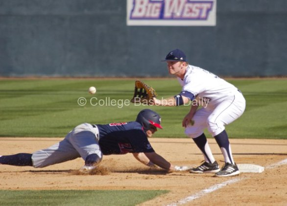 Connor Spencer takes the pickoff attempt.
