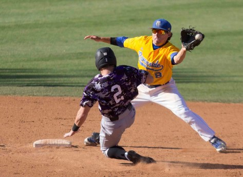 Joe Chavez reaches for a throw, but can't make the catch or hold the bag. (Photo: Mark Alexander)
