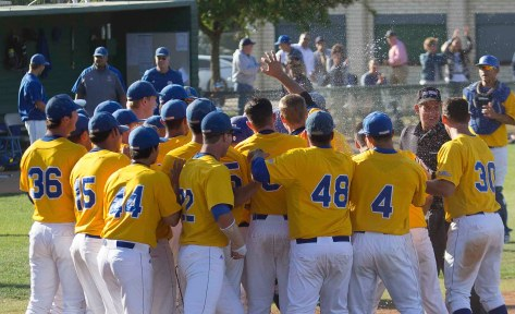 The UC Riverside team mobs Devyn Bolasky after his walk-off home run. (Photo: Mark Alexander)