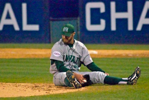 Matt Cooper looks at the mound after falling down during a pitch. (Photo: Shotgun Spratling)