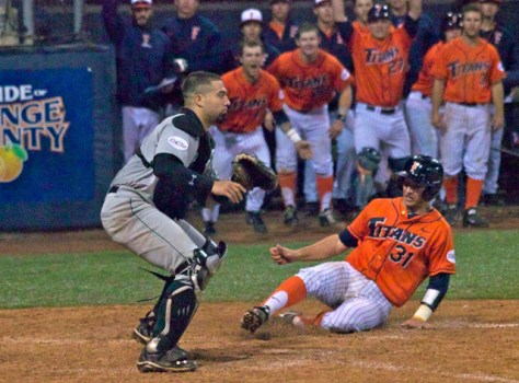 Jared Deacon slides in with the winning run. (Photo: Shotgun Spratling)