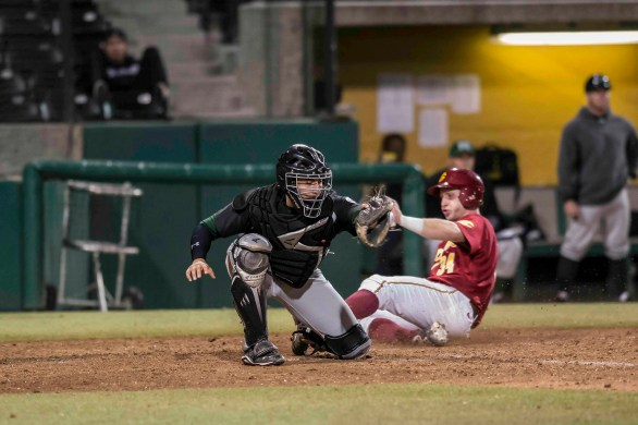 Kevin Swick slides in as the catcher awaits the ball. (Photo: Mark Alexander)
