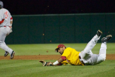 Jake Hernandez has to make a diving stop on a bunt attempt.
