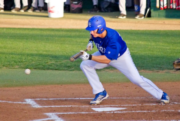 Alex Rubanowitz lays down a drag bunt. (Photo: Shotgun Spratling)