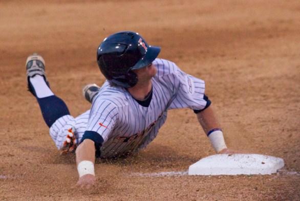 Keegan Dale steals third base.