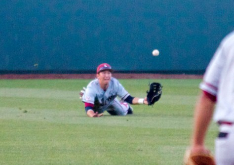 Austin Miller makes one of three diving catches against UCLA. (Photo: Shotgun Spratling)