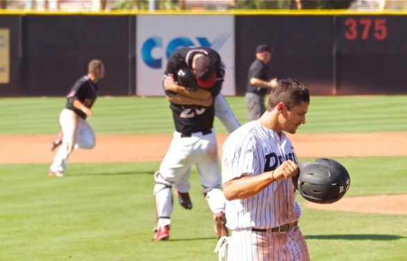 Brad Haynal lifts Michael Cederoth off the ground. (Photo: Shotgun Spratling)