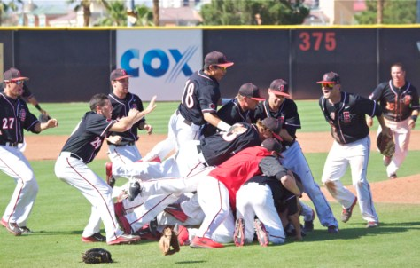 The Aztecs dogpile begins. (Photo: Shotgun Spratling)
