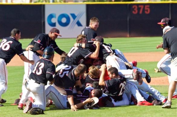 SDSU players share a hug on top of the dogpile. (Photo: Shotgun Spratling)
