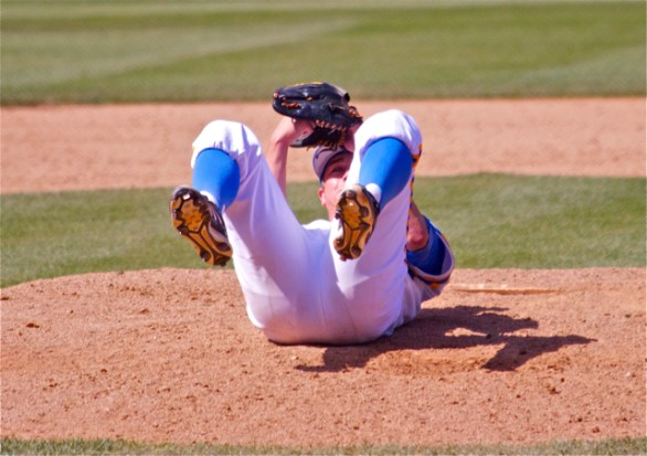 David Berg is knocked on his back after the game-winning hit goes right through his legs. (Photo: Shotgun Spratling)