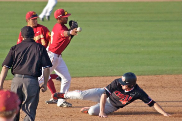 Reggie Southall turns the double play. (Photo: Shotgun Spratling)
