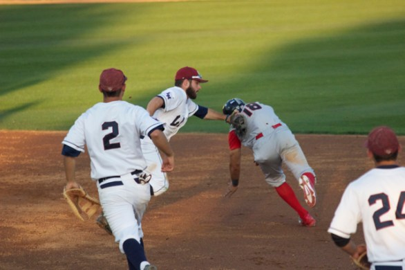 Brice Savage applies the tag to Tyler Adkison. (Photo: Shotgun Spratling)