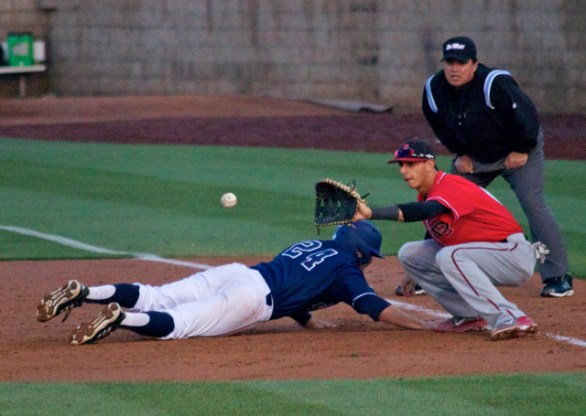 Kris Paulino dives back as Steven Pallares catches the throw. (Photo: Shotgun Spratling)