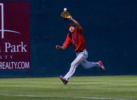 Seby Zavala runs down a ball near the line. (Photo: Shotgun Spratling)