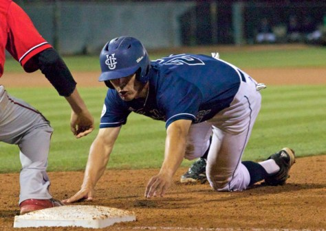 Chris Rabago dives back to first. (Photo: Shotgun Spratling)