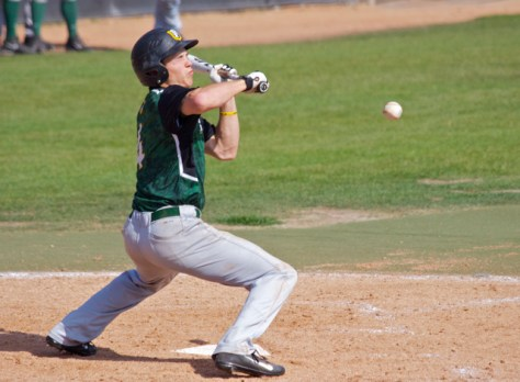Matt Sinatro nearly takes one in the face laying down a bunt. (Photo: Shotgun Spratling)