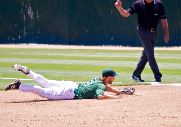 John Schuknecht makes a diving stop at 1B. (Photo: Shotgun Spratling)