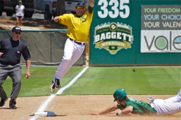Zack Zehner dives into third base. (Photo: Shotgun Spratling)