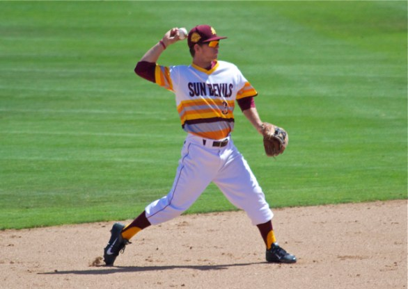 Tucker Esmay throws to first. (Photo: Shotgun Spratling)