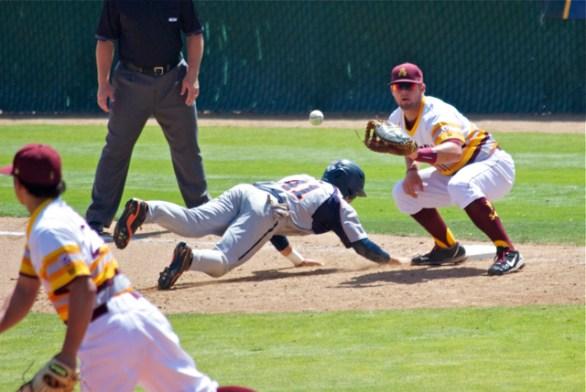 Nathaniel Causey takes the throw at first. (Photo: Shotgun Spratling)