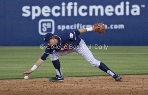Keegan Dale muffs a grounder for one of Fullerton's three errors.