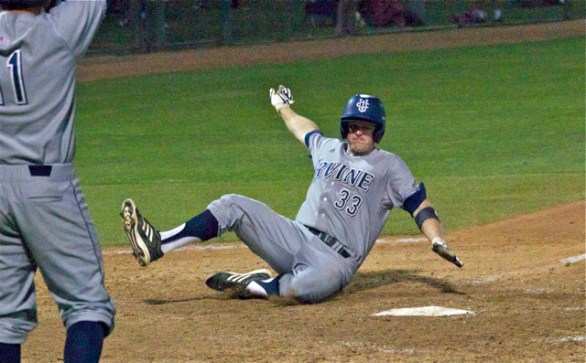 Connor Spencer slides in with the go-ahead run in the eighth inning. (Photo: Shotgun Spratling)