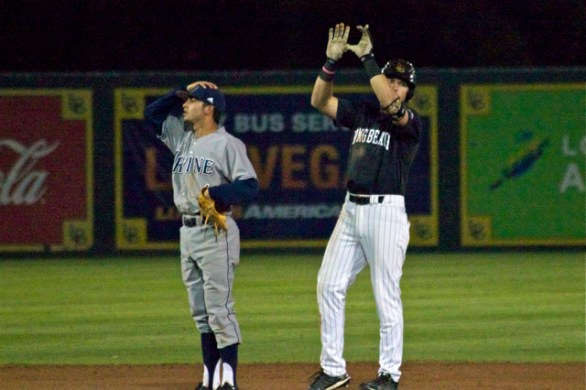 Richard Prigatano signals after his big hit while Mikey Duarte is in disbelief. (Photo: Shotgun Spratling)