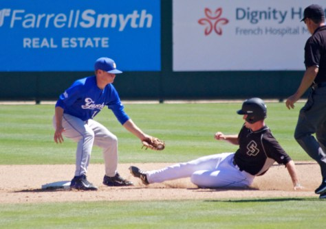 Ryan Clark puts the tag on Ryan Drobny. (Photo: Shotgun Spratling)