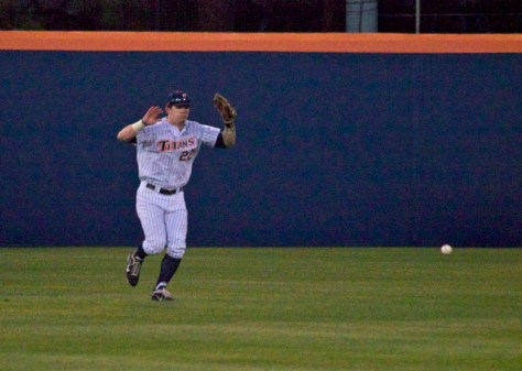 Austin Diemer dekes a catch in CF. (Photo: Shotgun Spratling)