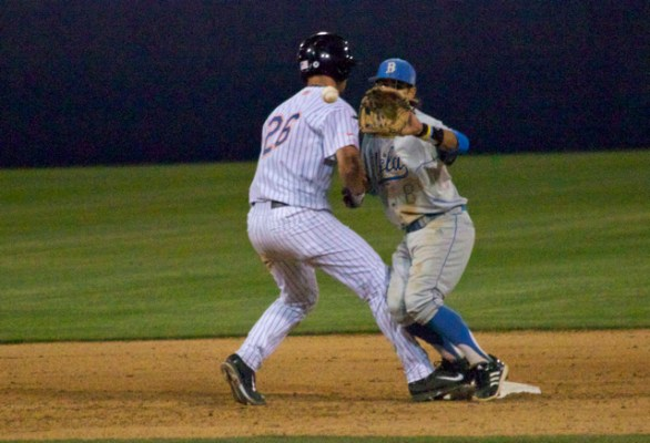 J.D. Davis puts his shoulder into Trent Chatterton at 2B. (Photo: Shotgun Spratling)