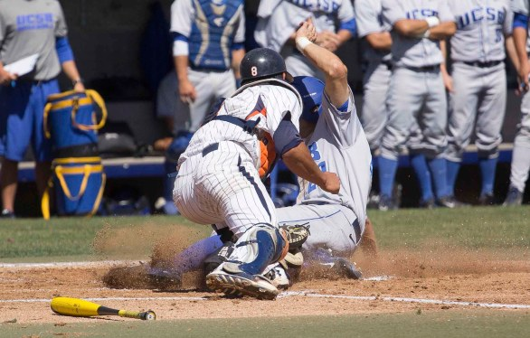 Joey Epperson slides in just ahead of the tag at the plate. (Photo: Mark Alexander)