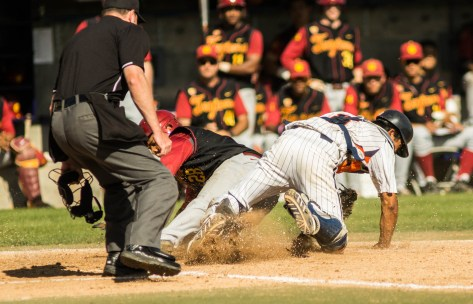 Timmy Robinson slides in under the tag at home. (Photo: Mark Alexander)