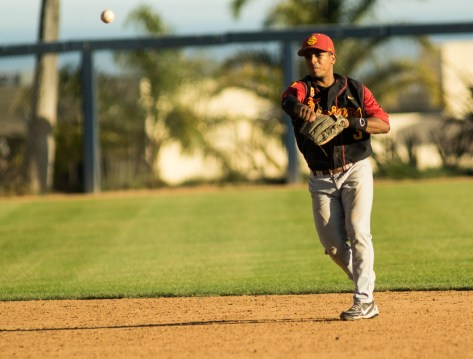 Dante Flores fires to first. (Photo: Mark Alexander)