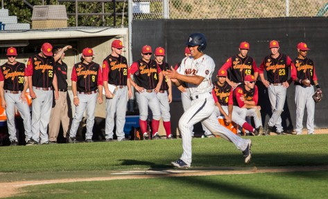 The USC bench looks on stunned as the winning run comes home. (Photo: Mark Alexander)