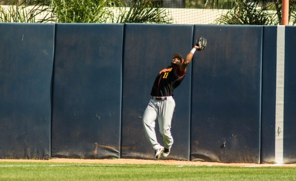 Omar Cotto makes a catch on the warning track. (Photo: Mark Alexander)