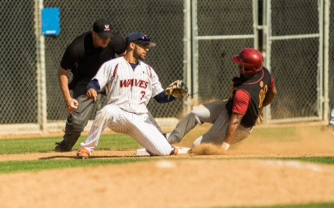 Omar Cotto slides in safely at third base. (Photo: Mark Alexander)