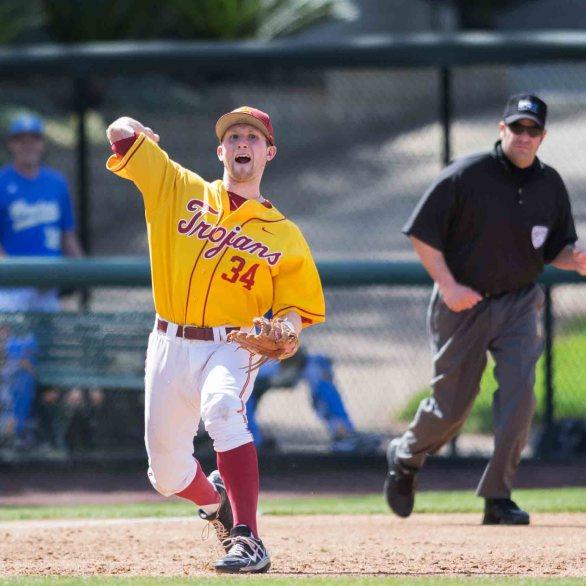 Kevin Swick throws across the diamond. (Photo: Mark Alexander)