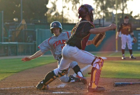 Cory Hunt slides into home. (Photo: Shotgun Spratling)