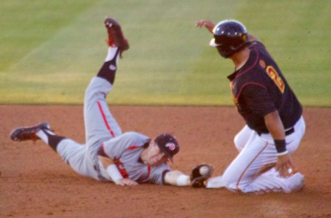Kody Davis tries to stretch back to tag Jeremy Martinez. (Photo: Shotgun Spratling)