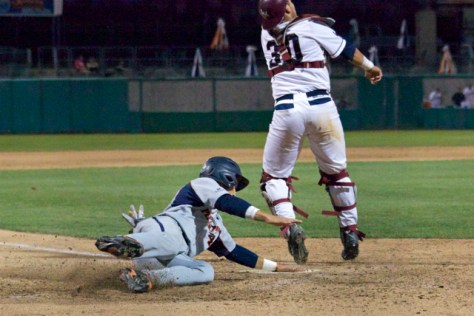 Brandon Caruso slaps the plate as he slide by. (Photo: Shotgun Spratling)