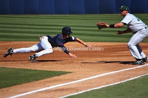 Michael Lorenzen dives back into first base