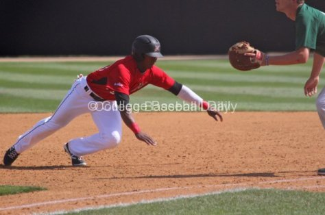 Miles Williams dives back into first base.