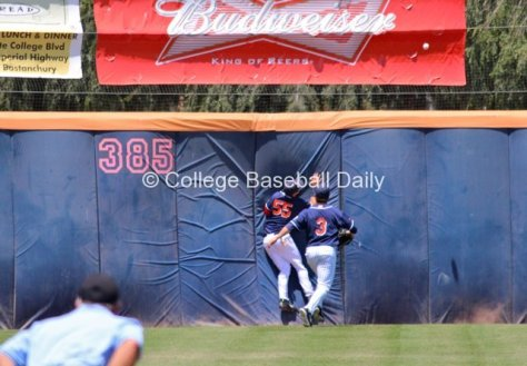 Michael Lorenzen crashes into the wall as the ball bounces off the orange stripe.