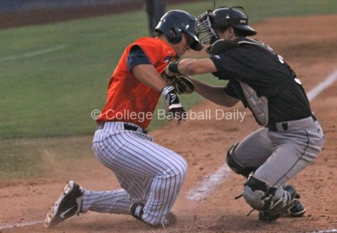 J.D. Davis gives Eric Hutting a push as he's tagged.