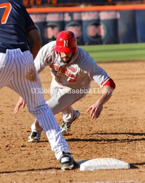 Chad Christensen dives back to first.